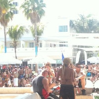 Photo taken at The Pool Parties at The Surfcomber by Caitlin M. on 3/27/2011