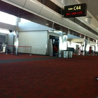 Photo taken at Gate C44 by Christopher P. on 4/22/2012