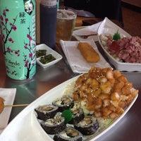 Photo taken at Sushi Hokō-Ki by Kar S. on 7/19/2012