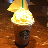 Photo taken at Starbucks by Anastasia P. on 7/12/2012