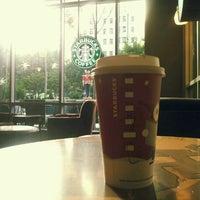 Photo taken at Starbucks by Yas on 12/4/2011