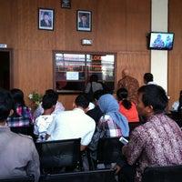 Photo taken at Kantor Dinas Kependudukan & Catatan Sipil kota Denpasar by Ayuni K. on 7/12/2012