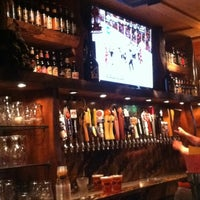 Photo taken at The Lodge Beer and Growler Bar by Neil Travis H. on 5/28/2013
