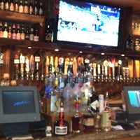 Photo taken at The Lodge Beer and Growler Bar by Neil Travis H. on 5/27/2013