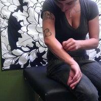 Photo taken at Autograf Tattoo by Lauren R. on 10/4/2012
