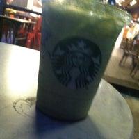 Photo taken at Starbucks by Arabella T. on 2/15/2014