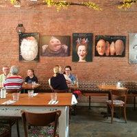 Photo taken at Domku Bar & Cafe by Tim C. on 5/9/2015