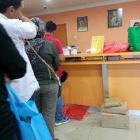 Photo taken at Pos Laju by Ridzuan A. on 12/21/2012