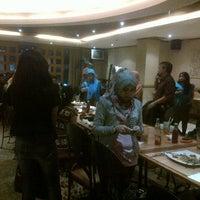 Photo taken at Tamani Kafe by Veny N. on 3/1/2013