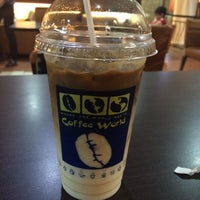 Photo taken at Coffee World by erica p. on 5/22/2015