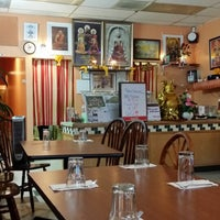 Photo taken at Srisiamchai Thai Restaurant by Kyle K. on 12/9/2013