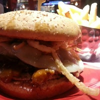 Photo taken at Red Robin Gourmet Burgers by Scott M. on 8/6/2013