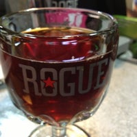 Photo taken at Rogue Ales Public House & Brewery by Mike K. on 2/6/2013