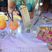 Photo taken at Wild Lotus Restaurant & Bar by Ivonne H. on 7/25/2014