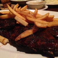 Photo taken at Outback Steakhouse by Brad C. on 11/30/2012