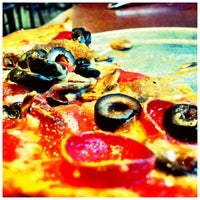 Photo taken at Amici's East Coast Pizzeria by Taciana D. on 5/28/2013