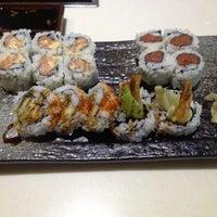 Photo taken at Fusion Fire Asian Fondue & Sushi Bar by Magen S. on 7/17/2013