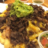 Photo taken at Rodeo Mexican Grill by stef m. on 6/27/2015