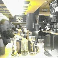 Photo taken at Buffalo Wild Wings by Bailey K. on 10/7/2012