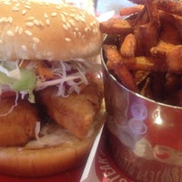 Photo taken at Red Robin Gourmet Burgers by Michelle D. on 10/18/2013