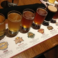 Photo taken at Rock Bottom Restaurant & Brewery by Makoto U. on 2/26/2013
