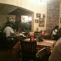 Photo taken at Italianni's Pizza, Pasta & Vino by LuigiAnton C. on 11/20/2012