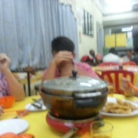 Photo taken at Feng Lin Steamboat Restaurant by Kong C. on 4/9/2013