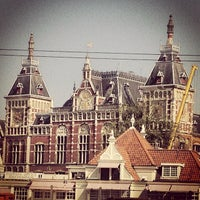 Photo taken at Amsterdam Centraal Railway Station by Burak T. on 8/23/2013