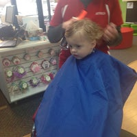 Photo taken at Kids' Hair by Erin A. on 4/6/2015