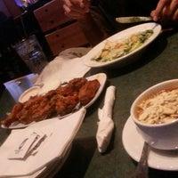 Photo taken at Smokey Bones Bar & Fire Grill by Abdullah A. on 5/2/2014