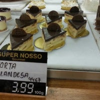 Photo taken at Super Nosso Gourmet by Djair S. on 2/23/2013
