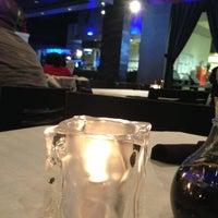 Photo taken at Rain Premier Sushi Bar & Bistro by Jenn S. on 3/31/2013
