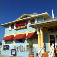 Photo taken at Mulligan's Beach House Bar & Grill by Jeronimo S. on 2/10/2013
