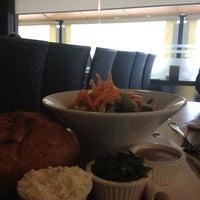 Photo taken at Café 111 by Adam A. on 12/17/2012