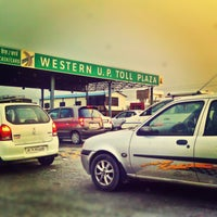 Photo taken at Western U.P. Toll Plaza by Anubhav T. on 3/28/2013