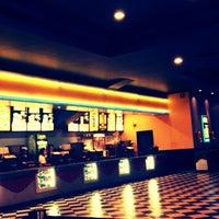 Photo taken at Super Cines 10 by Santiago C. on 3/4/2013