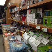 Photo taken at Giant Robot Store by Sang L. on 8/30/2014