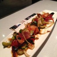 Photo taken at Sansei Seafood Restaurant & Sushi Bar by Eunice C. on 12/2/2012
