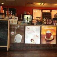 Photo taken at Lattetude Coffee Lounge & Bistro by Sarah C. on 4/3/2013