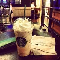 Photo taken at Starbucks by jakrit on 4/5/2012