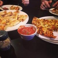 Photo taken at Erbelli's Gourmet Pizzeria, Italian Bistro & Pub by Discover K. on 4/7/2014