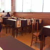 Photo taken at Betto's Grill by Juan I. on 12/21/2012