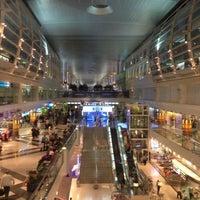 Photo taken at Dubai International Airport (DXB) by Barbara D. on 7/5/2013