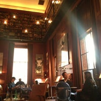 Photo taken at The Library at Hudson Hotel by Peter D. on 2/15/2013