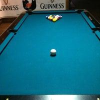 Photo taken at Mulligan's Pub by Jen N. on 12/8/2012