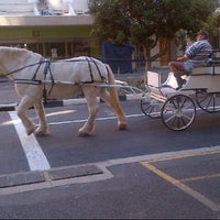 Photo taken at Cape Town Tourism by Tawedzerwa Z. on 5/4/2013