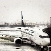 Photo taken at Calgary International Airport (YYC) by Ian F. on 3/17/2013