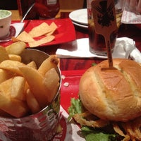 Photo taken at Red Robin Gourmet Burgers by Jaybo M. on 6/29/2013