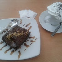 Photo taken at Capriccio Cafe & Gelatto by Irving M. on 8/28/2013