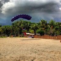 Photo taken at Palawan Beach by Benjamin L. on 12/15/2012
